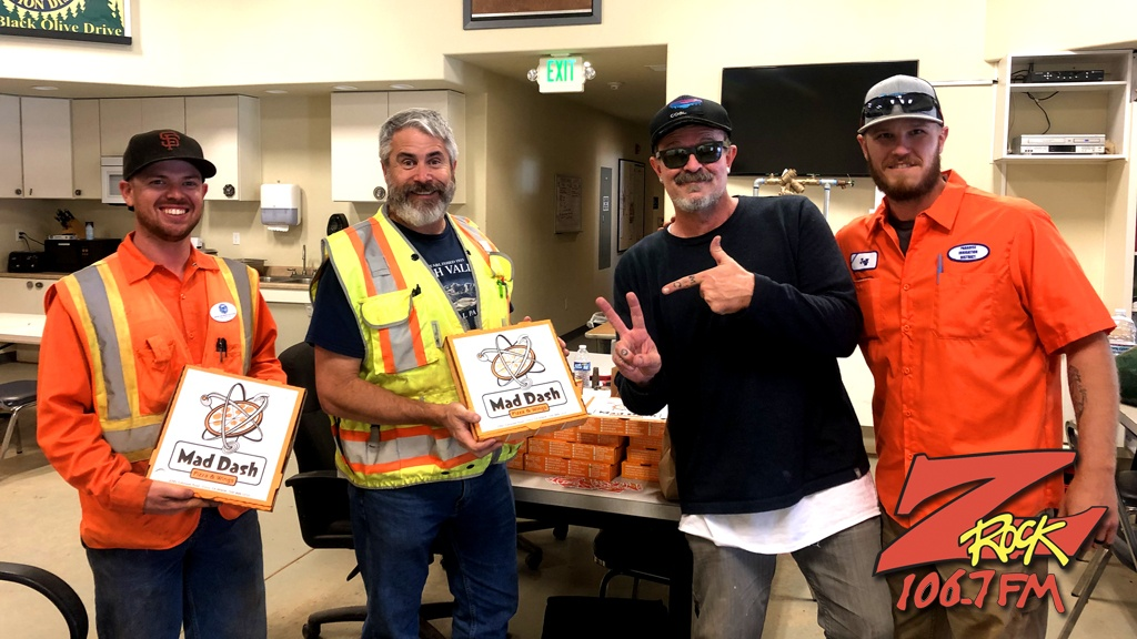 Tim Buc Moore with winners from Paradise Irrigation District for the Z-Rock Munch Box on 106.7 Z-Rock