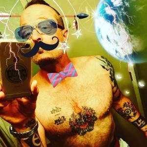 106.7 Z-Rock's Tim Buc Moore taking a bizarre bathroom mirror selfie complete with jackass Instagram filters