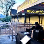 Listener looks on as Tim Buc Moore broadcasts live at Great Northern Coffee for Wake the Buc Up 2019 (sponsored by Riley's) 2/21/19