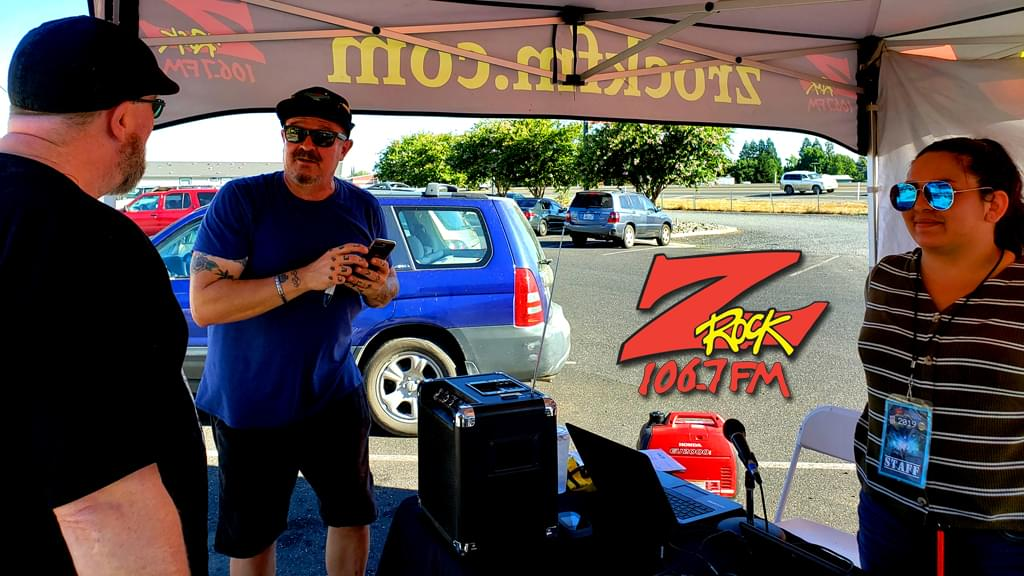 Tim Buc Moore chopping it up with a Buc Head at Code 3 Coffee for Wake the Buc Up 2019 sponsored by Riley's on 106.7 Z-Rock
