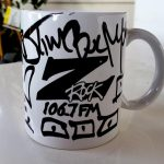 "A world famous Z-Rock ""doodle"" mug customized by Tim Buc Moore for Wake the Buc Up 2019 at Gridley Grill & Crab Shack on 106.7 Z-Rock October 31st"