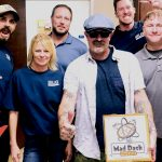 Tim Buc Moore with winners from Selig Construction for the Z-Rock Munch Box on 106.7 Z-Rock