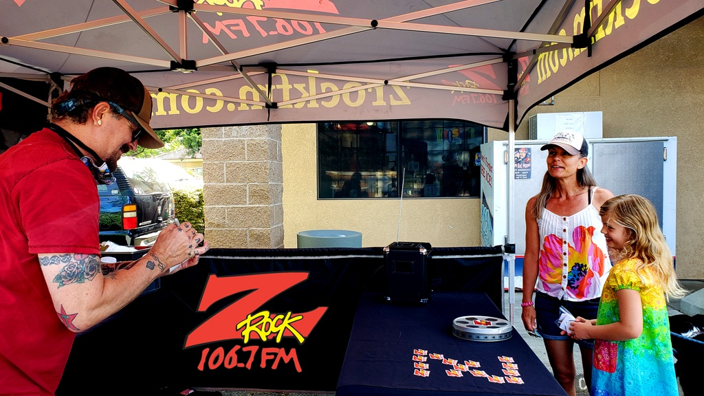 Tim Buc Moore doodling on a Z-Rock mug at PV Circle K Chevron in Chico California for Wake the Buc Up on 106.7 Z-Rock