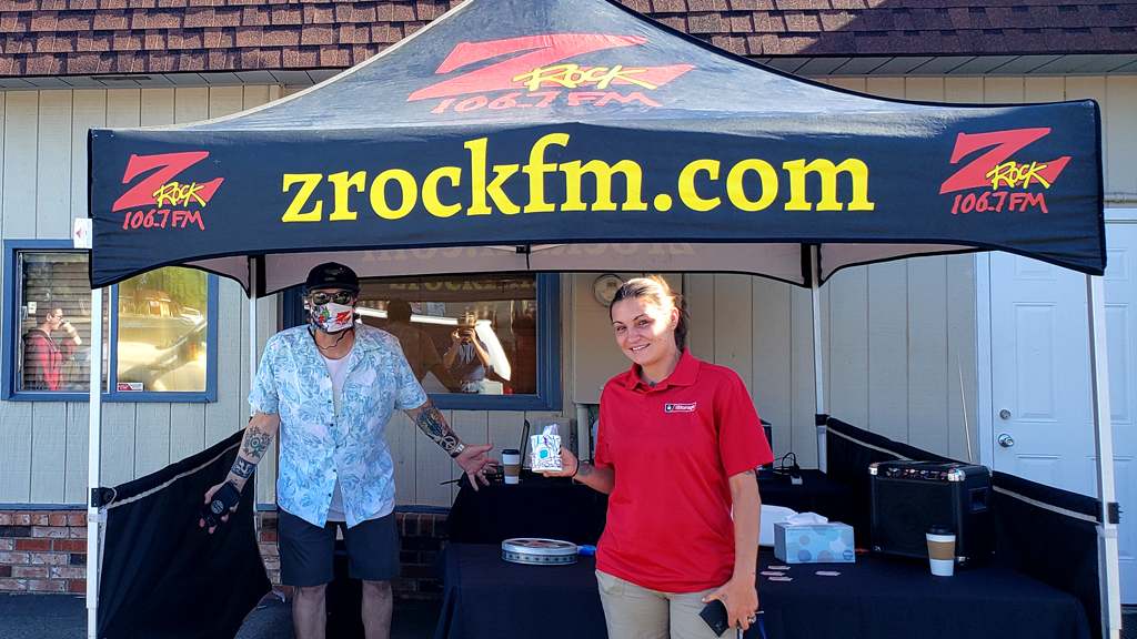 Tim Buc Moore with a loyal Buc-head at Lots' A Java in Oroville California for Wake the Buc Up on 106.7 Z-Rock