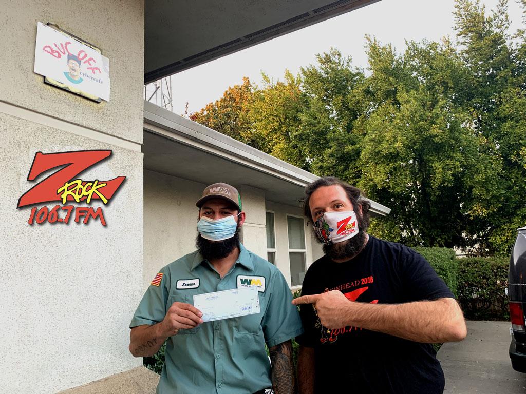 Boris with Pumpkinhead 2020 winner Josh Proffer picking up his $1,000 cheque outside Casa de Z-Rock