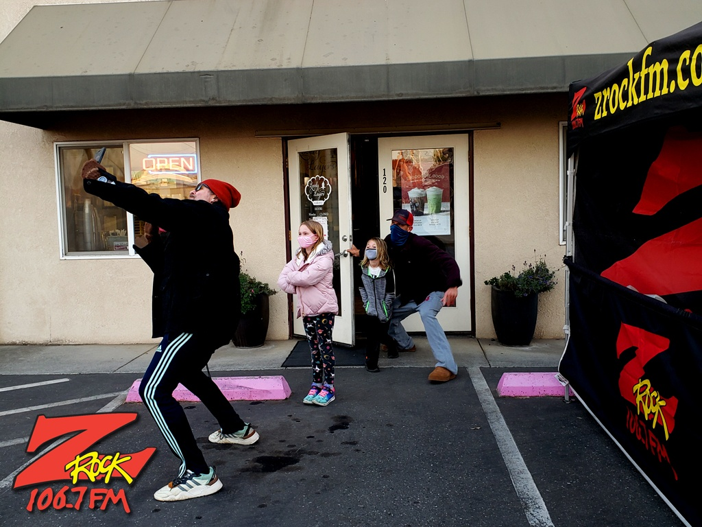 """Tim Buc Moore executing a forced perspective selfie with loyal """"Buc Heads"""" at Lovely Layers Cakery in Chico CA for Wake the Buc Up on 106.7 Z-Rock"""