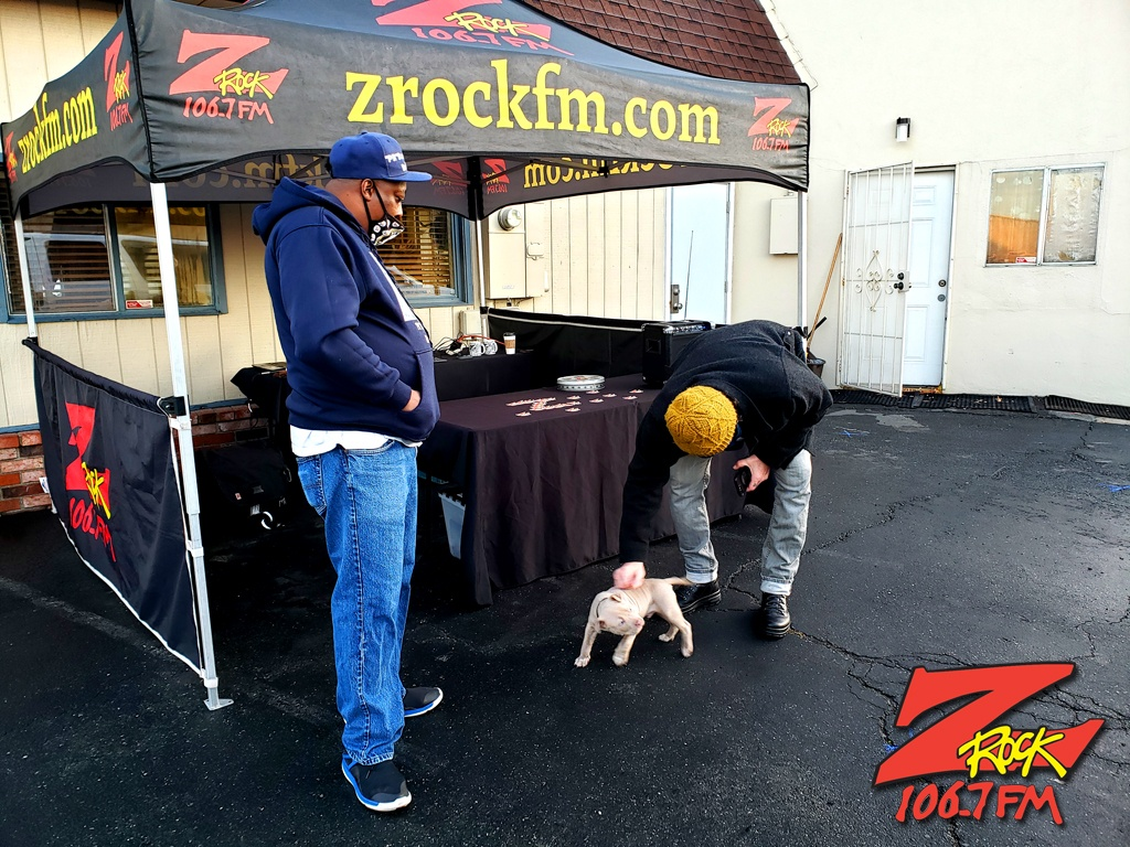 Tim Buc Moore with loyal Buc-Heads (one human and one canine) at Lots 'A Java in Oroville CA for Wake the Buc Up on 106.7 Z-Rock