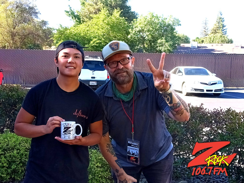 Tim Buc Moore with a loyal Buc-Head at Chico Creek Coffee in Chico CA for Wake the Buc Up on 106.7 Z-Rock June 17th 2021